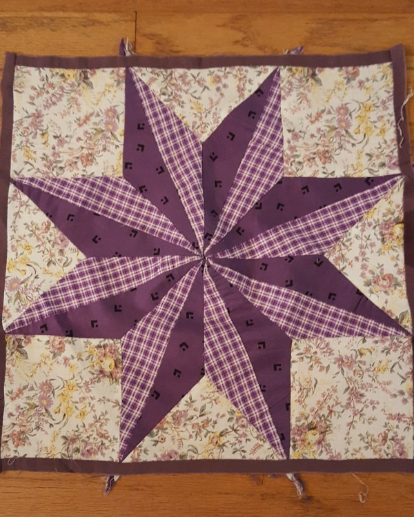 Quilt block in Lemoyne Star pattern