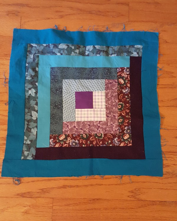 Log Cabin block teals on one side purples on the other
