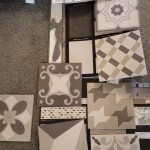 Tile and wall paper samples in gray tones.