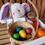 Easter basket with dyed eggs and plush bunny