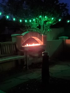 Fire glowing in outdoor fireplace
