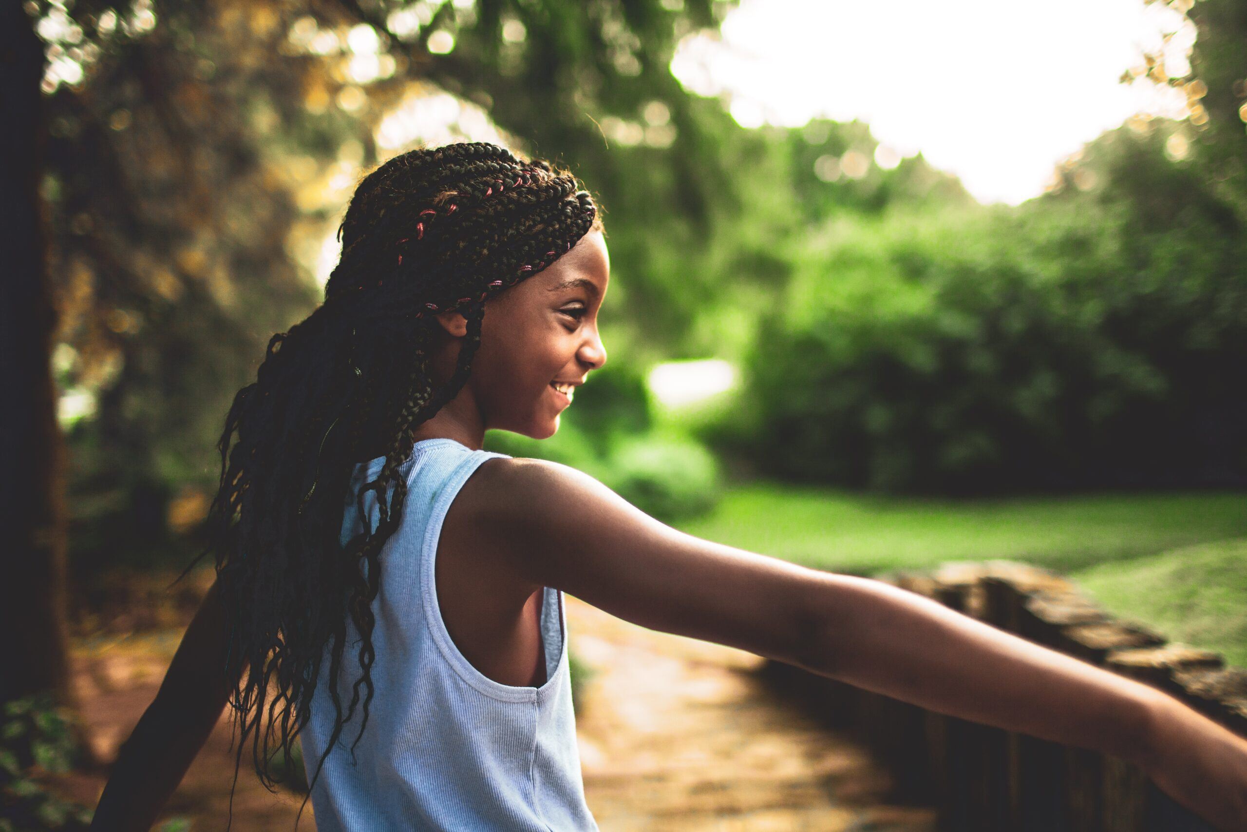 young black person smiling and enjoying nature