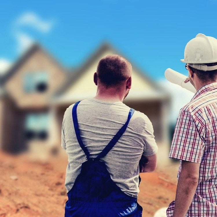 Builders in Spain assessing a property