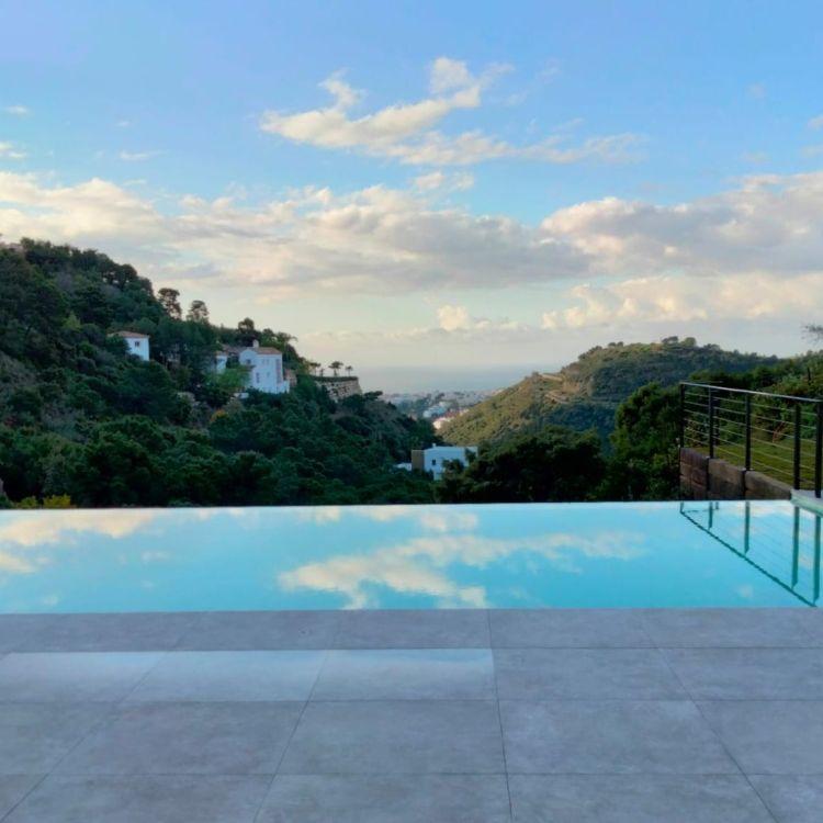 Swimming pools are common in Spanish villa designs
