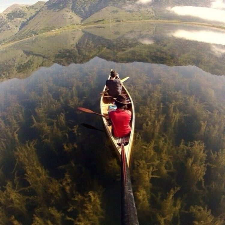 Canoeing the a Crystal Clear Lake, Italy