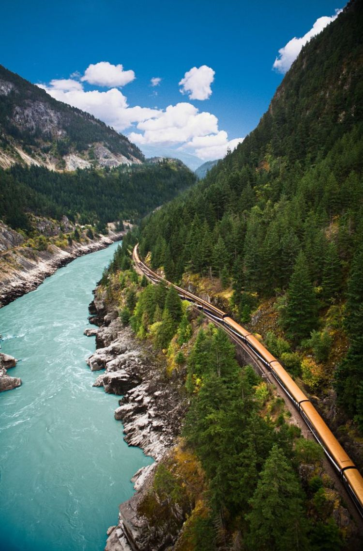Rocky Mountaineer train... Would really make you appreciate Canada