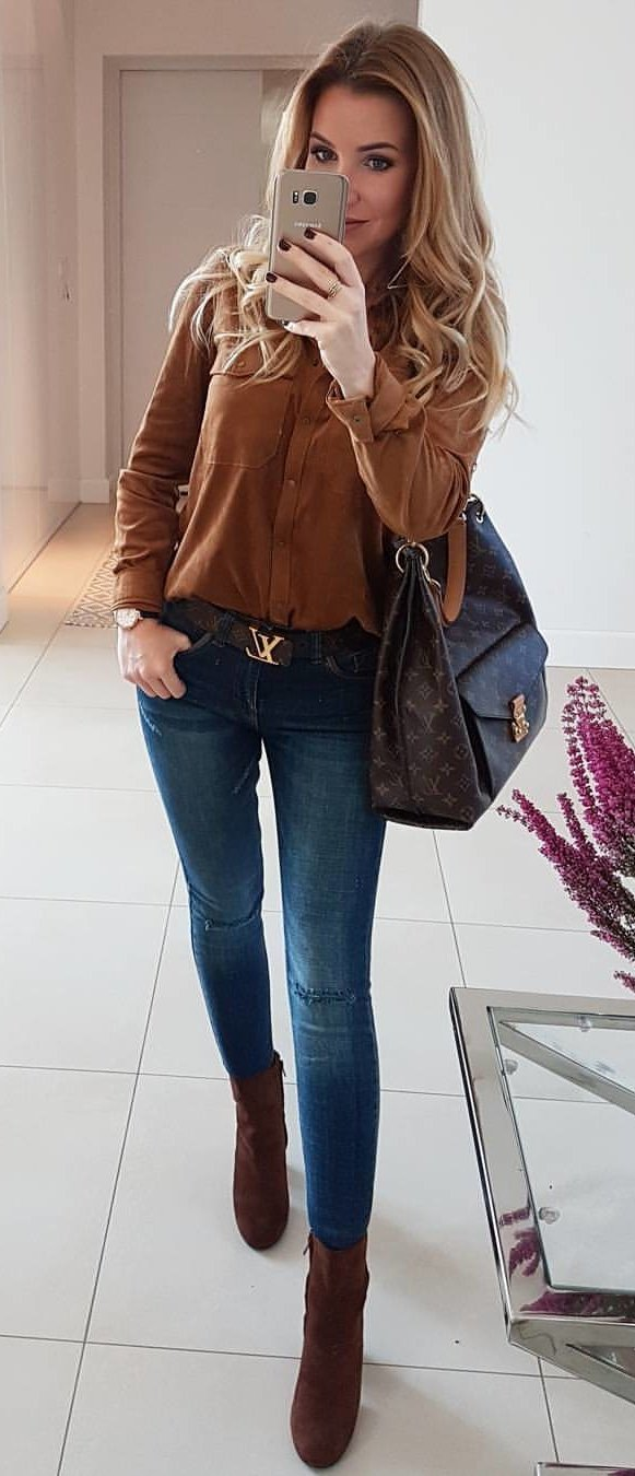 women's brown button up long sleeve shirt and blue jeans outfit