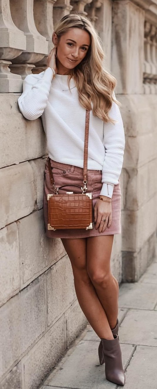 women's white longsleeved top and brown mini skirt withpair of brown shoes