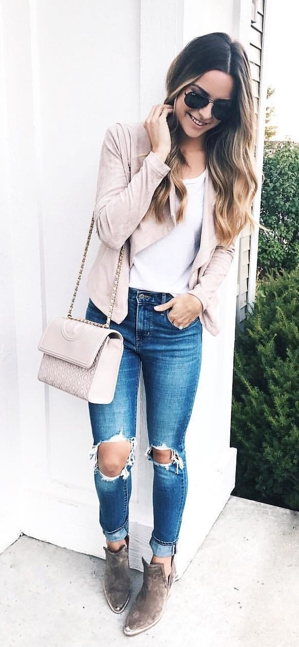 women's white top, beige cardigan, distressed jeans, and brown booties outfit
