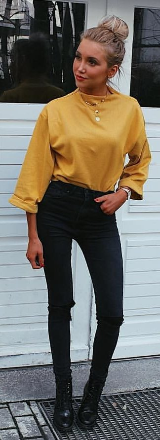 Yellow long sleeve top; black jeans Source
