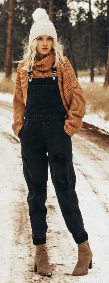 girl's brown sweater and blue denim overall pants