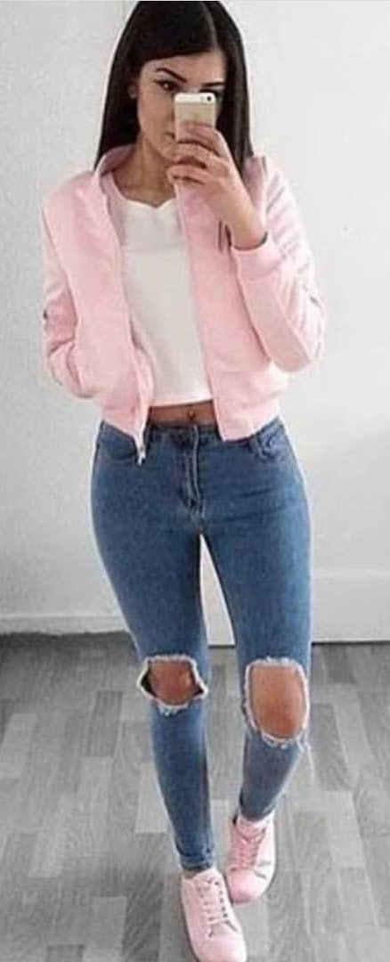 gold zip-up jacket, white top, and distressed blue jeans