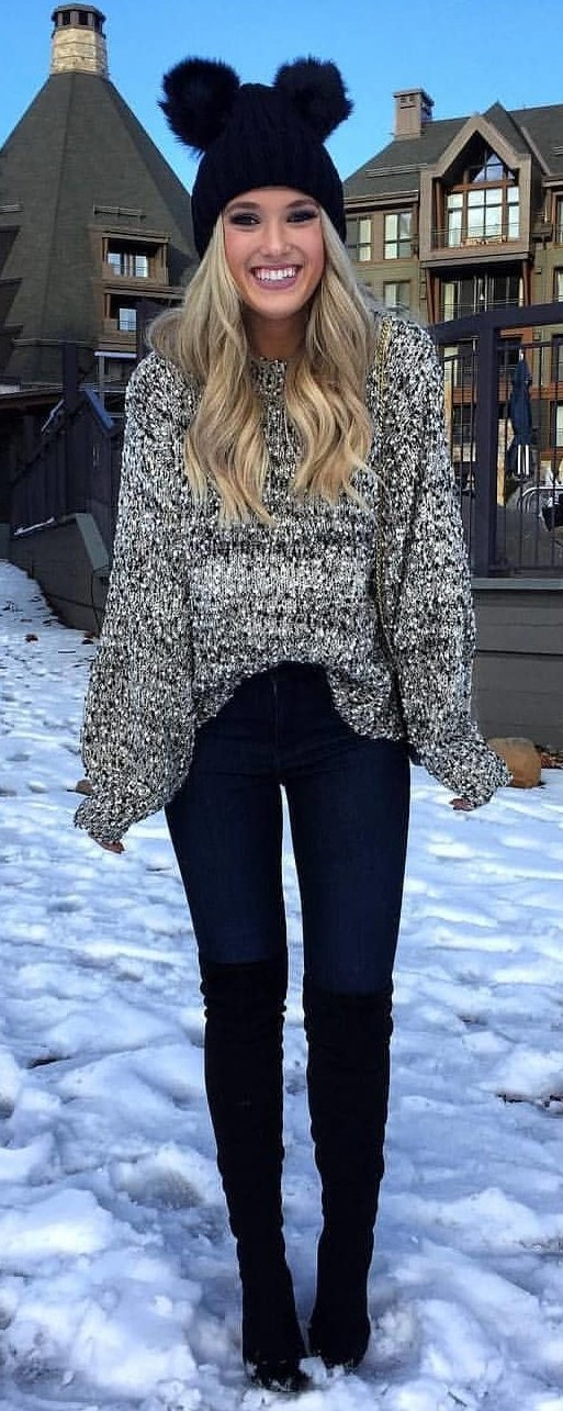 gray knit sweater with black pants and black boots