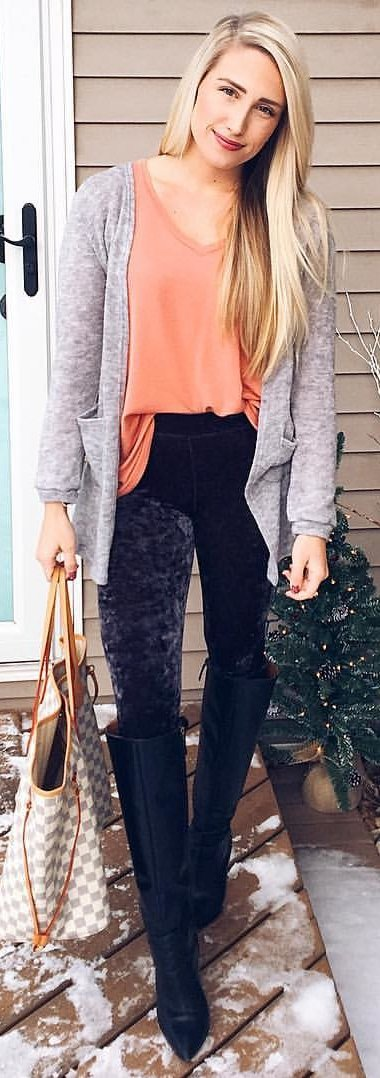 orange scoop-neck shirt and gray cardigan