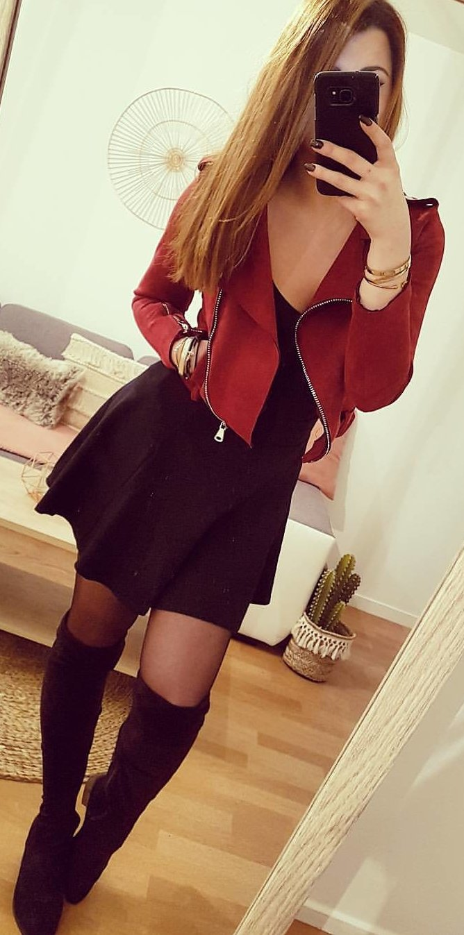 red coat and black scoop neck cocktail dress