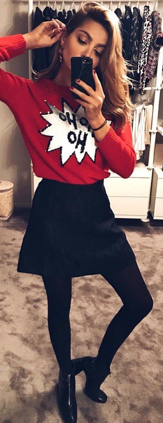 red printed crew-neck sweater; black skirt