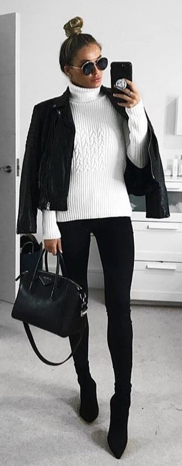 white cable knit sweater and black panst