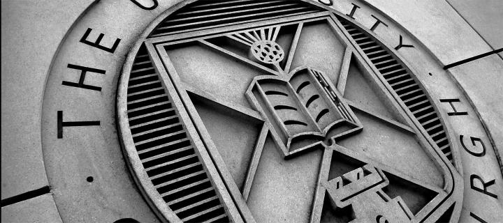 A close up of the university crest