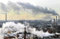 A smoke from the chimneys billow over St. Petersburg, 03 March 2005. Russia's greenhouse gas emissions fell by up to 38 percent between 1990 and 1999 due to its economic collapse in the early 1990s, according to a UN report, giving Moscow broad room to manoeuvre despite recent rapid economic growth. The Kyoto Protocol, the strictest environmental agreement concluded by the international community, entered into force thanks to its ratification by Russia in October 2004. AFP PHOTO / SERGEY KULIKOV / INTERPRESS (Photo credit should read SERGEY KULIKOV/AFP/Getty Images)
