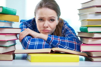 frustrated teacher surrounded by books