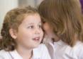 two schoolgirls sharing a secret