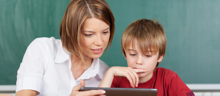 Teacher and student looking at a tablet