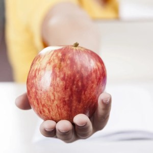 holding apple learning