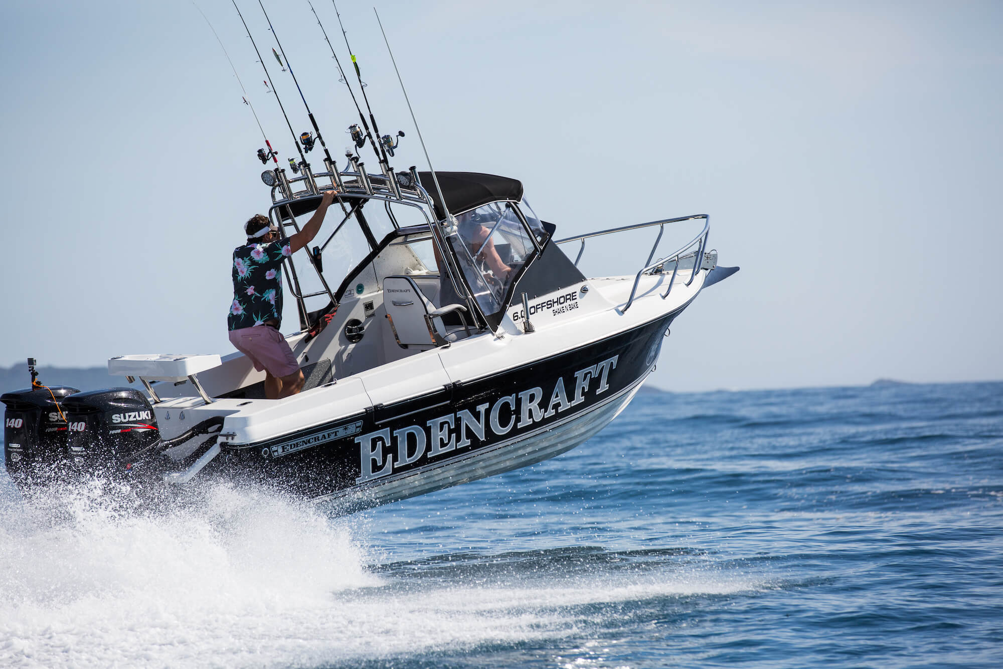 Man hangs on to rocket launcher as Edencraft 6.0m Offshore boat launches from the water