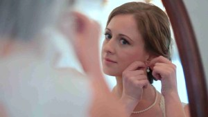 Bride puts on earings