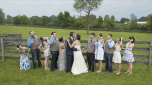Bridal party takes photo in field