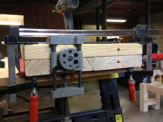 Using the dowel jig to drill the breadboard dowel holes