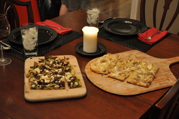 Date night dinner of pesto, mushrooms and caramelized onion pizza and chicken, artichoke heart and pineapple pizza