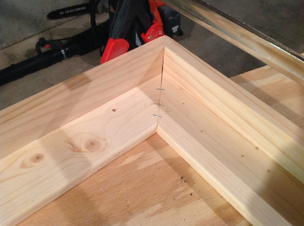 Use a staple gun to add some stability to the frame corners. Once you clamp down, you can staple both sides of the frame.