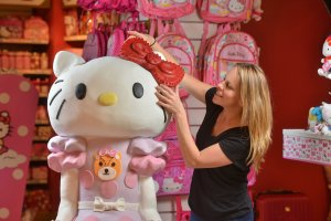a close up of a 5 foot tall cake that looks like Hello Kitty with the maker Sarah Hardy