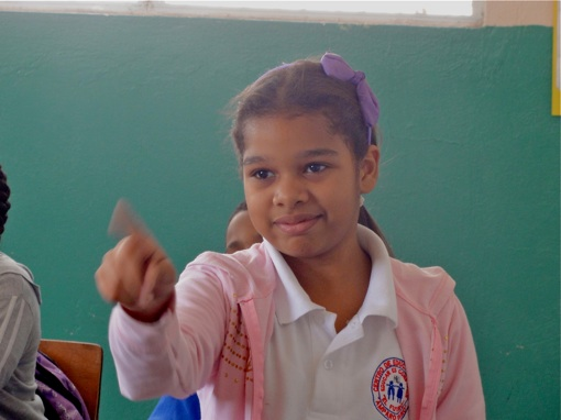 """This girl wags her finger """"no"""". We love seeing an opinion being expressed. It is our hope that the students in these schools would think critically about their lives, their environment and their world."""