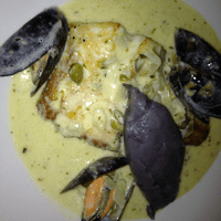 Ling with a caper beurra blanc, blue potato pure and mussels.