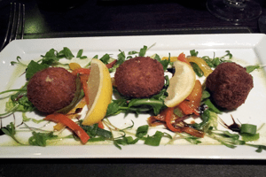 Salty brandade balls and slinky peppers, salad and lemon all working together.