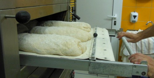 An ingenious way of loading the loaves into the oven