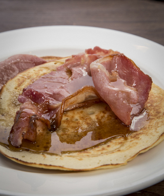 Crispy bacon, fluffy pancake and syrup. Copyright Brendan MacNeill