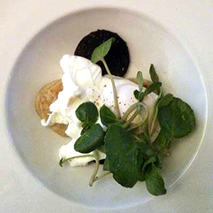 Potato scone, black pudding and poached egg.