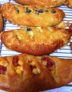 These are savoury fougasse - a dough made with plenty of olive oil and stuffed with a variety of fillings.