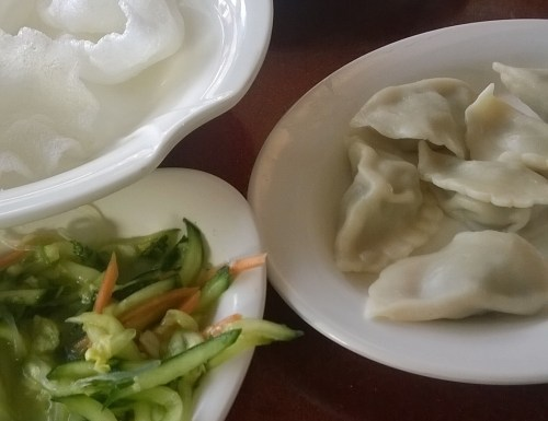 Prawn crackers, pork and coriander dumplings, cucumber and noodle salad