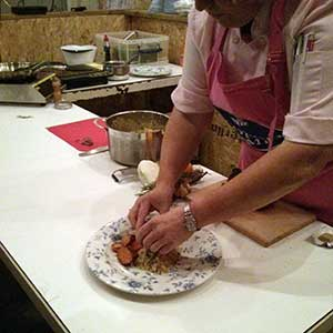 Jaqueline O'Donnell plates up lamb loin with couscous.