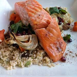 Moroccan salmon with bulgur wheat, roast fennel and roast squash.