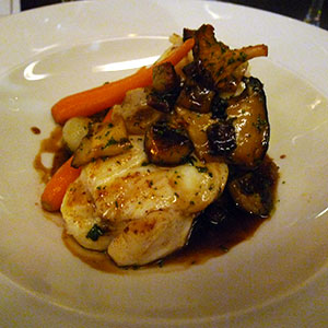 Monkfish on the bone, with a rich red wine sauce, bacon and wild mushrooms.