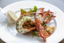 Grilled lobster with garlic & parsley butter and a crisp salad. Brendan MacNeill