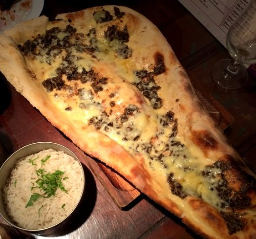 The enormous naan - topped with cheese and haggis