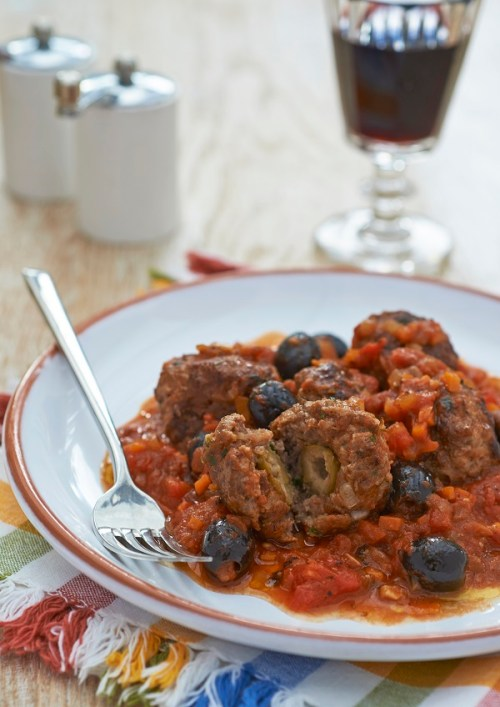 Juicy meatballs stuffed with tangy olives.