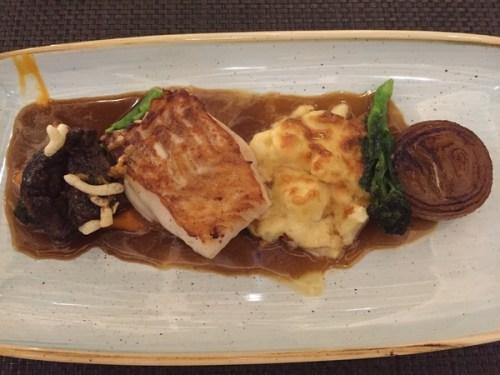 North Sea cod with Iberico pork cheek & cauliflower cheese gratin