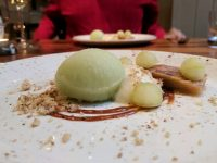 Apple terrine with miso butterscotch and applee and tarragon sorbet. In the background, my dining companion.